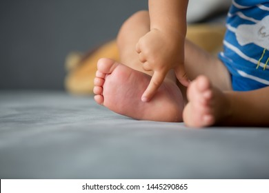 Children feet, sting by a bee, summertime