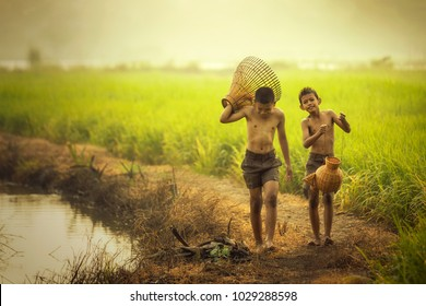 Children fisherman are fishing in the field.