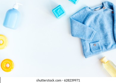children flat lay with clothes white background top view space for text