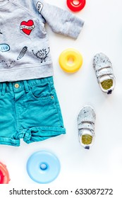 children flat lay with clothes white background top view