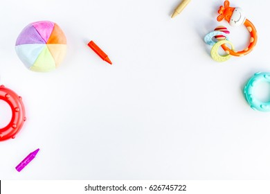 children flat lay with toys white background top view space for text