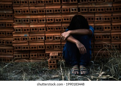 Children are forced to work in the construction area. Human rights concepts, stopping child abuse, violence, fear of child labor and human trafficking