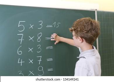 Children in front of blackboard at school.