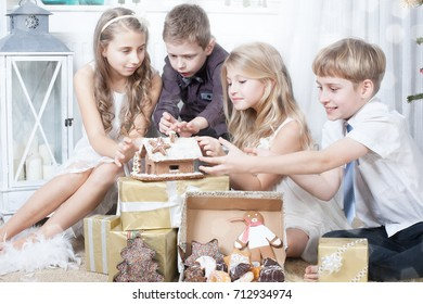 children - gifts and gingerbread under christmas tree christmas concept