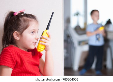 children girl and boy playing with walkie-talkie