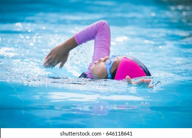 Children girl in swimming pool , Asian Girl , Thailand