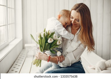 Children give mother flowers. Family at home. Mothers day