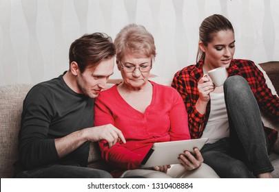 Children giving senior mother financial adviser. Senior insurance.