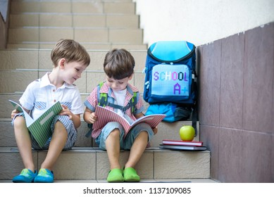 Children go back to school. Start of new school year after vacation. Two Boy friends with backpack and books on first school day. Beginning of class. Education for kindergarten and preschool kids.