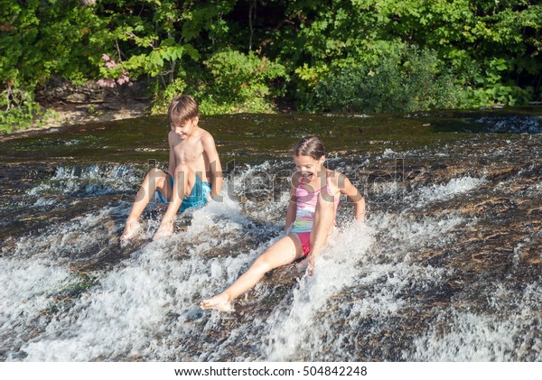 Children go down the rapids of river in Lake Superior, Pictured Rocks National Lakeshore, Michigan, USA