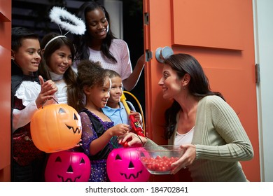 Children Going Trick Or Treating With Mother