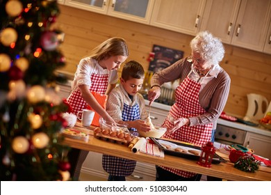 children and grandmother preparing Christmas cookies-Family time