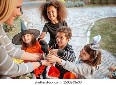 Children in Halloween costumes, trick or treating