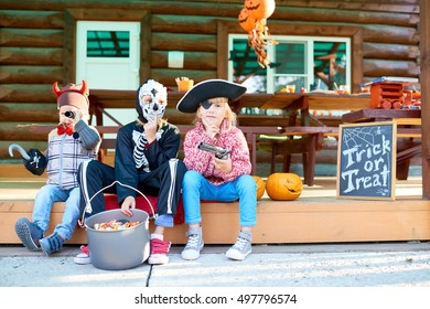 Children in Halloween costumes waiting for holiday