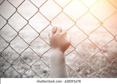 children hand with steel cage