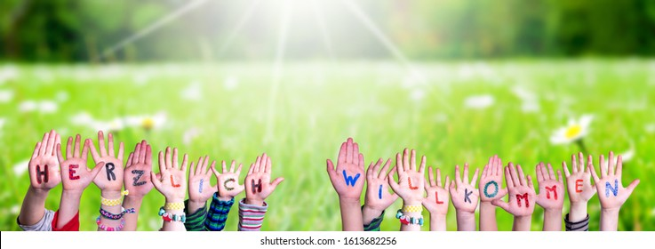 Children Hands Building Word Herzlich Willkommen Mean Welcome, Grass Meadow