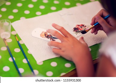 Children hands making artworks with wood and paint crafts. workplace and handcraft Decoupage