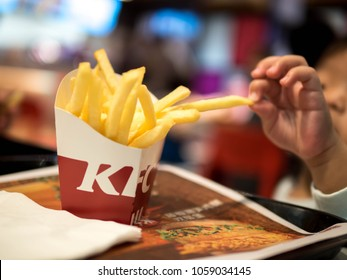 Children hands Picking Kfc french fries on table, French fries