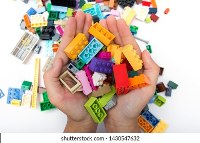 Children hands play with colorful lego blocks ,white blackground