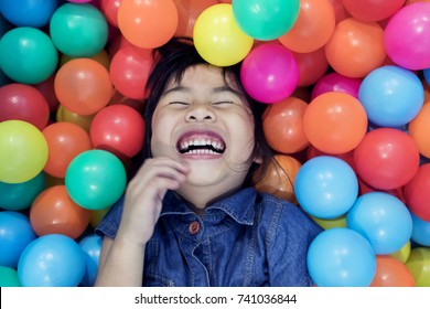 children happiness emotion in colorful on ball pool