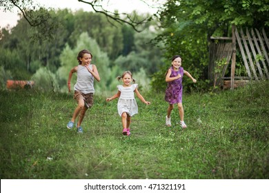 The children happy outdoors in the village.