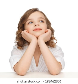 children and happy people concept - picture of pre-teen girl in casual clothes looking up and thinking