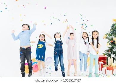 Children are having fun and enjoying the party. Everyone has faces, smiling, running, playing, and enjoying balloons. In the studio, white background in Bangkok, Thailand