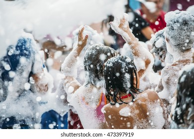 Children having fun in foam party.