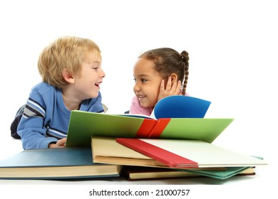 Children having fun looking at a book together