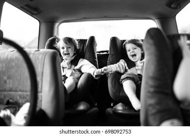Children having fun on car journey