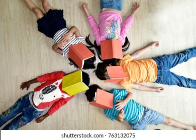 children  having fun on learning  in an international school library.teacher ,education, kid and primary school concept .
