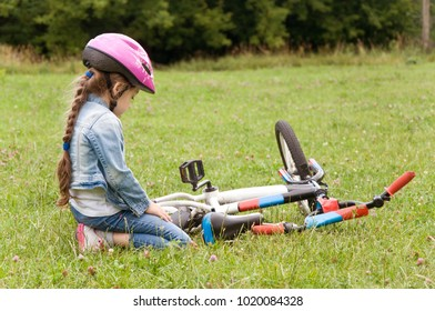 children having fun outdoors. children ride a bicycle. healthy lifestyle. active rest. hobby
