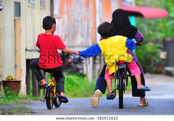 Children having fun riding bicycles.