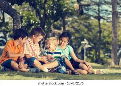 Children having fun using digital tablet