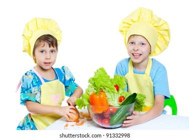The children help prepare the cooks