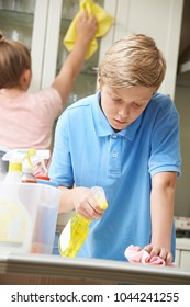 Children Helping With Household Chores And Cleaning Kitchen