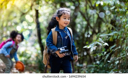 Children hiking in mountains or forest. Kids Camping summer. Two funny little girls having fun during forest hike on summer. Friend forever