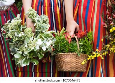 Children holding a flower basket.