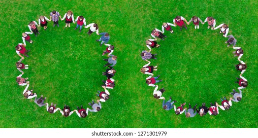 children holding hands in circle. green meadow scene, aerial view