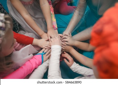 Children holding hands. Community. Game. All together.