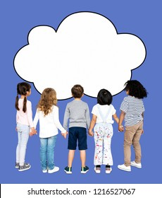 Children holding hands and looking at a cloud shaped board