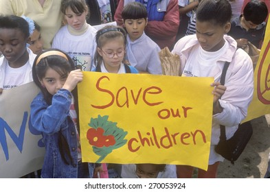 Children holding signs at anti-gang community march, East Los Angeles, California