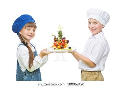 Children holding tree shape fruit snack