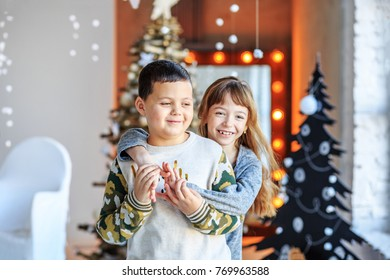 Children hug and laugh. Brother and sister in the room. Concept Happy Christmas, New Year, holiday, winter, childhood.