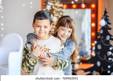 Children hug and laugh. Brother and sister. Concept Happy Christmas, New Year, holiday, winter, childhood.