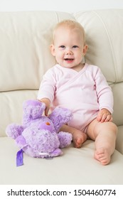 Children, infant and childhood concept - beautiful smiling baby sitting