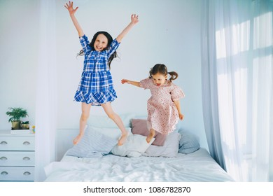 The Children are jumping on the bed.