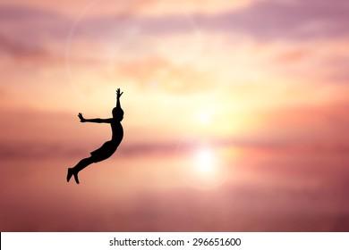 Children Jumping silhouette Sunset background