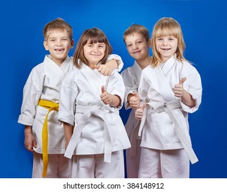 Children in karate gi are showing finger super