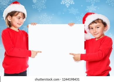 Children kids christmas Santa Claus snowing pointing looking empty copyspace copy space